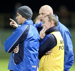 Eyes fixed on the League: Selectors Ger Power, Tony Corcoran and manager Tom McGlinchey.