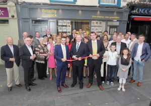 Minister of State at the Dept. of the Environment, Paudie Coffey TD pictured cutting the tape at the opening of Brophy Cusack on Friday last.