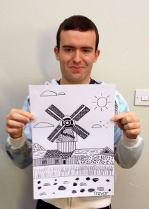 Trevor Marks proudly displays one of his drawings