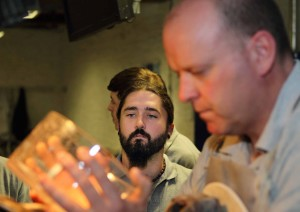 Recent Waterford Crystal cutting apprentice Chris Phelan watching Master Cutter Damien O'Regan at work. MEP Sean Kelly has called for 'GI' status to be afforded to 'The Glass'.