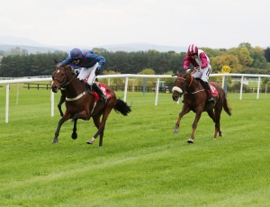 Petuna Ridden by Sean Houlihan Winning the Mares Flat Race from Earth Sister ridden by Patrick Mullins, 2nd, right, and Cashelard Lady Ridden By JJ King, Far Side.