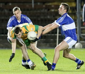 Bonmahon's Shane Dwan is tackled by Ballinameela's Colin Walsh and Tom Curran during the JJ Kavanagh & Sons Intermediate Football final in Fraher Field.