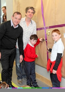 Gael Scoil na nDeise Principle Marc de Grás with artist Sean Corcoran and pupils Ethan O'Deoráin and Jack O'Connail who unveiled the mosaic.