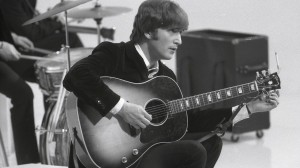 John Lennon playing his J-160E Gibson guitar that was discovered after being lost for 50 years.