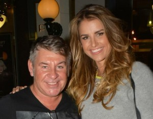 Michael Doyle, pictured with Vogue Williams, one of his many happy clients.