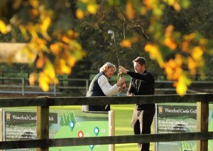 Waterford Castle Golf Club professional, Ryan Madigan giving a lesson to club member Cathy Murphy