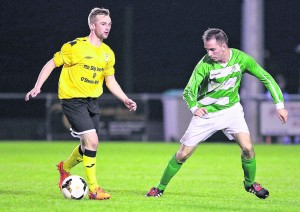 Tramore's Johnny St Leger takes on Villa's Danny Walsh.