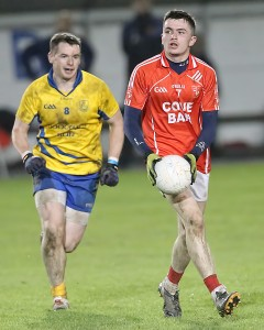 Stradbally's Jack Mullaney steers away from The Nire's Shane Walsh at Fraher Field on Saturday last.