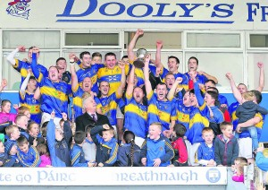 Portlaw, captained by Frank Galvin, celebrate their JJ Kavanagh & Sons Ltd IHC victory over Modeligo at Walsh Park on Sunday last