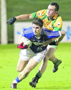 Ballinameela's Brian Phelan and Bonmahon's Eoin Firzgerald tangle duruing last Wednesday's IFC Final replay at Fraher Field.
