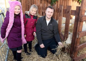 Metropolitan District Mayor Eamon Quinlan pictured with Zoe Murphy and Kayleigh Greene feeding the sheep at the Live Animal Crib on Friday last at Ballybricken.