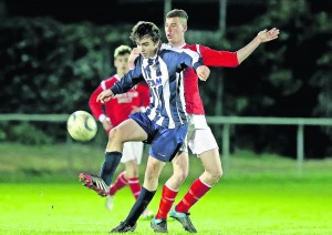 Waterford's Michael O'Neill gains control ahead of Cork's Troy O'Sullivan.
