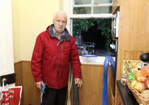 David Power standing next to the pumps clearing out his kitchen at his home in Portlaw on Wednesday morning last after flood water from the overflowing River Clodagh swamped his home during the height of Storm Frank.