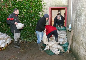 Sandbags being installed by relatives and friends of the Power family.