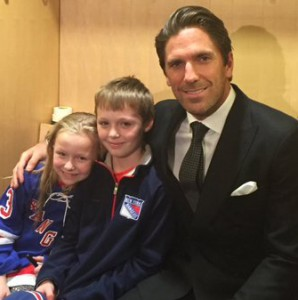 Kayleigh and her brother RJ with New York Rangers' star Henrik Lundqvist.