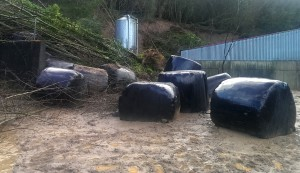 Bales of silage, driven into the Dunnes' farmyard by the December 30th landslide