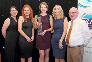 Patricia Jackman IS pictured with the May Monthly winner, Beth Carton and members of the Waterford County Camogie Board (2015), Roisín Hartley (PRO), Ita Murphy (Chairperson) and John C Flood.