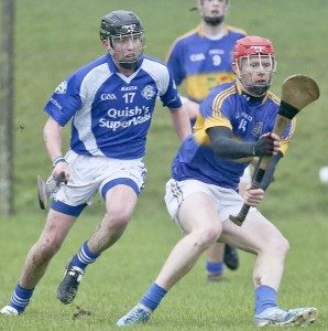 DJ Foran, who was double marked for much of Sunday's Final, steers away from Tramore's Matthew Thompson.
