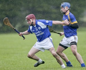 Tramore's Conor Lynch struggles to break clear from Portlaw's Jack Walsh.