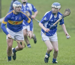 Tramore's Jack O'Byrne about to clear, with Portlaw's Jake Scanlon in pursuit.