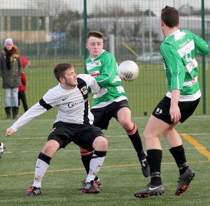 Seanie Martin of Tramore heads for goal against Kilmallock United in the Munster Youths Cup at Carriganore last Sunday.