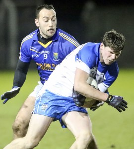 Waterford's Patrick Hurney tussles with Wicklow's Anthony McLoughlin during last year's NFL opener at Fraher Field.