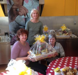 Sharon Fleming from the Faithlegge Residents Group presenting an Easter hamper to Marian O'Flynn. Also pictured is Project Co-ordinator Mags Drohan.