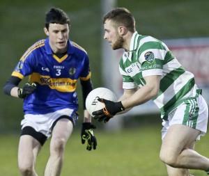 Ballinacourty's Shane O'Donovan with the ball against An Rinn's Darach Ó Cathasaigh during lasty Friday's SFC meeting at Fraher Field.    Photos: Sean Byrne