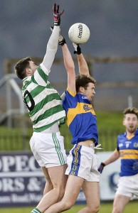 Ballinacourty's James O'Mahony in aerial action with An Rinn's Ferdia Ó hAodha.