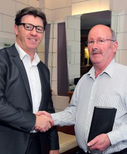The gathering assembled to discuss Waterford United's financial future at the Woodlands Hotel on Wednesday last. Inset: Blues boss Roddy Collins with Martin Flavin, Secretary of the Waterford & District Football League.