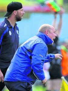 The Deise boss issues instruction, with selector Dan Shanahan in the background.