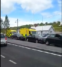 A scene from video which shows cars mounting the median on The Quay to allow ambulances to pass.