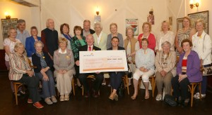 Chair of Waterford Daffodil Day committee Des Daunt presenting a cheque to Eileen Kearney, Irish Cancer Society. Included are committee members and volunteers. Photo: John Power.