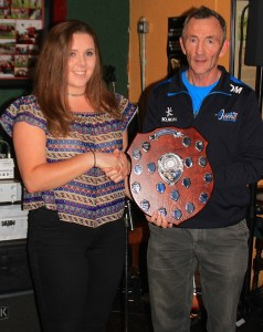 Labhaoise Dunbar is presented with the shield for the ladies championship by Chairman, Dermot Murray.