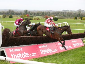 Arctic Skipper ridden by Sean Flanagan jumping the last fence to win the tote.com Fortria Steeplechase from Gilgamboa and the Game Changer
