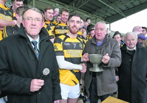 Anthony Walsh (Munster Council Treasurer) presents the Munster Club Intermediate Hurling trophy to Lismore skipper Paudie Prendergast. Also pictured is Liam Lenihan (Vice Chairman, Munster Council) and Jimmy O'Gorman (former Munster Council Chairman and a proud Lismore man!)