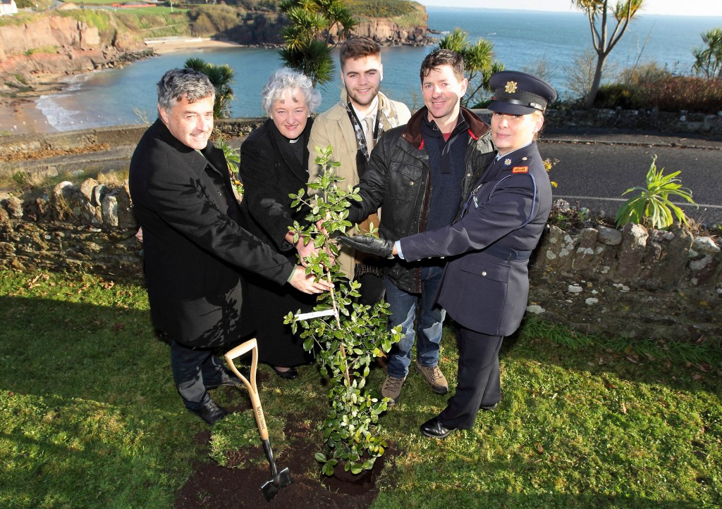 Mayor of Waterford City & County Council, Cllr Adam Wyse planted a tree to mark the opening of the Dunmore East NeighbourWood Scheme on Friday last. He is pictured with Fr Brian Power, PP, Dean of Waterford, Revd Maria Jansson, Tommy Enright, Forestry Services Ltd and Superintendent Carmel Banville. | Photo: Noel Browne