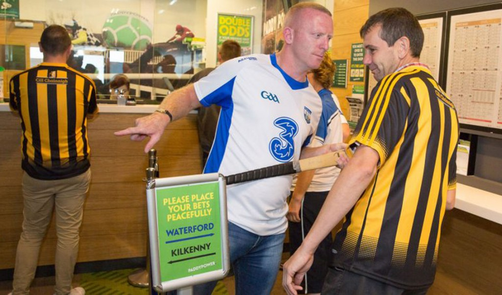 """John Mullane poses during a pre-All-Ireland semi-final press snap for a well-known bookmaker in Ferrybank last August, which dubbed the area """"hurling's Gaza Strip""""."""