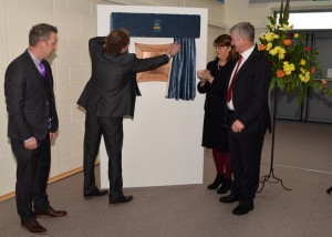 Cllr John Hogan (Chairperson, Tipperary ETB)  unveils the commemorative plaque to mark the official opening of Comeragh College on Thursday last. Also pictured are Principal Kevin Langton (left), Fionnuala McGeever (CEO, Tipperary ETB) and former Comeragh College Principal Pat Callanan. 						| Photos: Joe Cashin