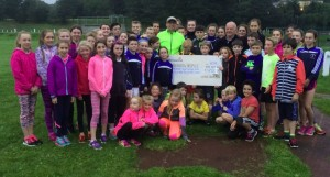 Young athletes and members of St. Senan's AC with Cllr. Tomás Breathnach, Hospice Support  group, Kilmacow, at the presentation of funds from the Little South Run.