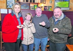 Pictured holding the winning ball at the recent Waterford Sports Lotto draw held in the Old Ground Bar were Fiona Murphy, Catherine Hannigan, Brendan Duignan and Eddie Dunphy. The winning numbers were 8, 16, 22 and 24 and there was no jackpot winner. Maurice Murray (Bolton FC) and Betty Hughes (Bolton FC) both matched three numbers and won €50 each. The final draw of 2016, which will be a Christmas party night for the SWaterford Sports Group, takes place at The Olde Ground on Tuesday, December 13th at 6pm.   Photo: Noel Browne