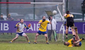 Dr Crokes' Daithí Casey completes his hat-trick in spectacular fashion at Mallow, slamming the ball beyond Tom Wall and Justin Walsh.   Photos: Brian Morrissey