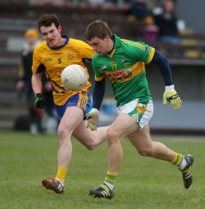 A race for possession between Gaultier's Sean Hogan and The Nire's Liam Cooney.