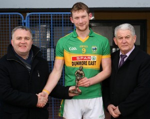 Gaultier's Caomhan Maguire accepts the JJ Kavanagh Man Of The Match trophy from Sean Michael O'Regan (Waterford County Board Vice-Chairman) and Waterford County Board Chairman Paddy Joe Ryan.