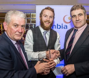 Adult Footballer of the Year Thomas O'Gorman (The Nire) receives his prizes from Paddy Joe Ryan and Glanbia's Brendan Hayes.