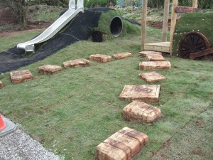 The playground at Durrow features railway suitcases as stepping stones.