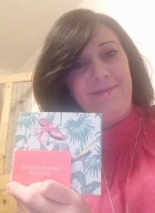 A delighted Caroline Whelan with her gift voucher which she received from a kind stranger.