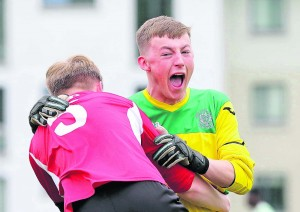 De La Salle goalkeeper Shane Burke can't hide his delight at the final whistle as he celebrates with team mate Tim Skelly