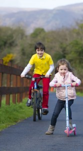 Leah Moran-Saunders and Joshua Moran-Davy pictured on the Waterford Greenway. Inset: Minister of State John Halligan.