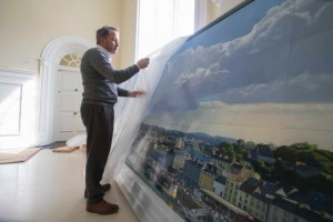 Celebrated artist, Blaise Smith, unpacking his painting of Waterford commissioned by The Office of Public Works and Waterford City & County Council.